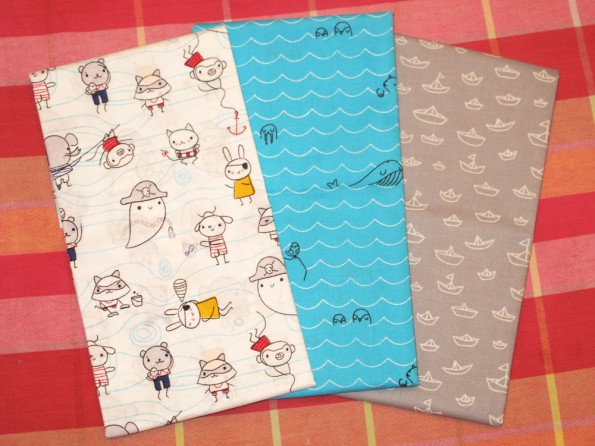 Fun, fun, fun! These are organic cotton. It's Seven Seas collection by Michéle Brummer Everett for Cloud9 Fabrics. These prints are Sea Critters, Laddies and Poppets, and The Fleet in Grey.