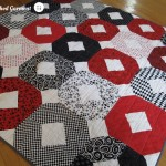 Red Xs and Os quilt by The Finished Garment